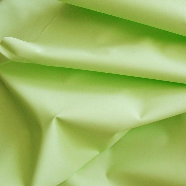 Lindgrüner laminierter Parka Stoff